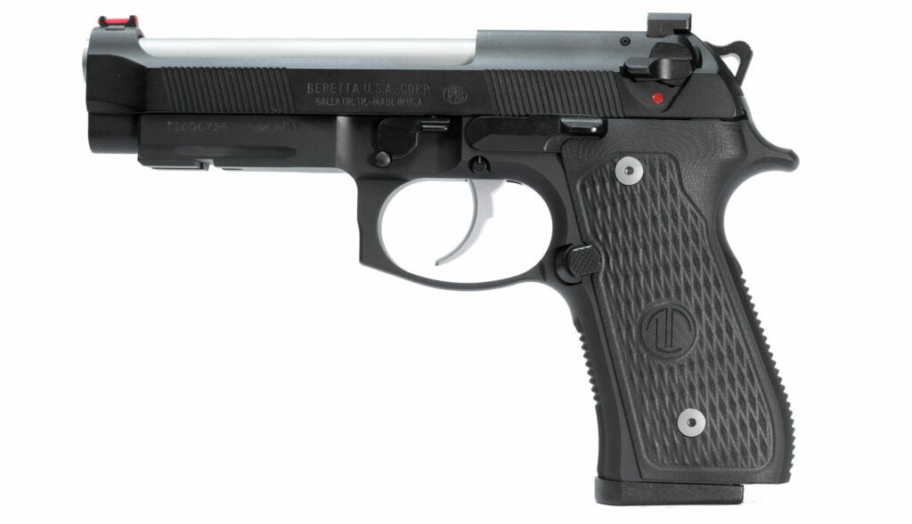 The other side of the gun, showing the oversized magazine release button.