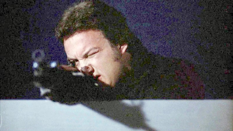 Barry (Belushi) with an HK91 rifle watching Frank's back at the harbor.