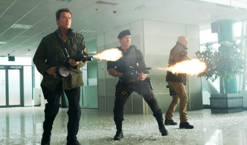 Stallone as Ross firing his Noveske alongside action icons Arnold Schwarzenegger as Trench and Bruce Willis as Church.
