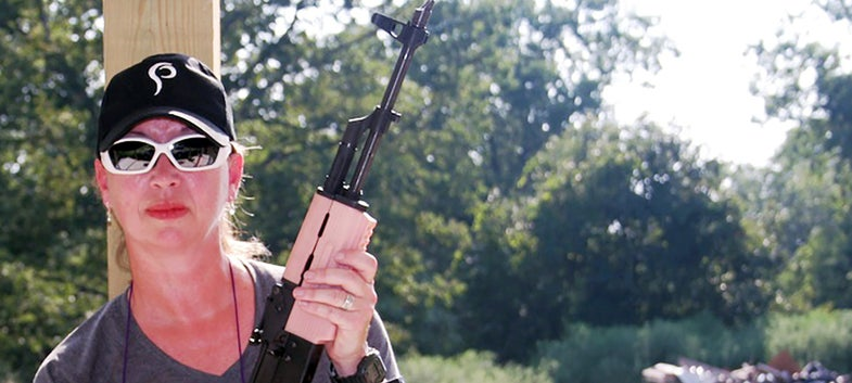 barbara baird wearing safety glasses and holding a rifle