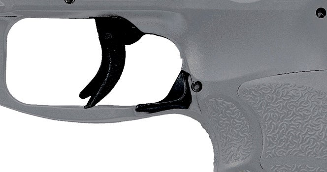 An example of the paddle-style magazine release on a standard grey-framed HK VP9 pistol.