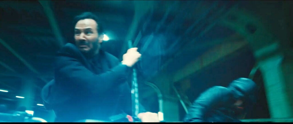 Keanu taps into his inner Neo for some katana work atop a motorcycle.