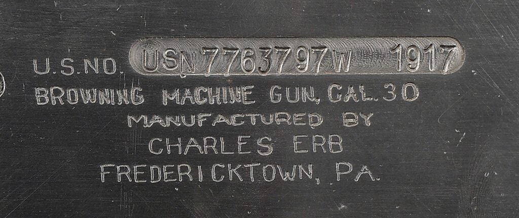 A closeup of the plate on the Colt Model 1928.