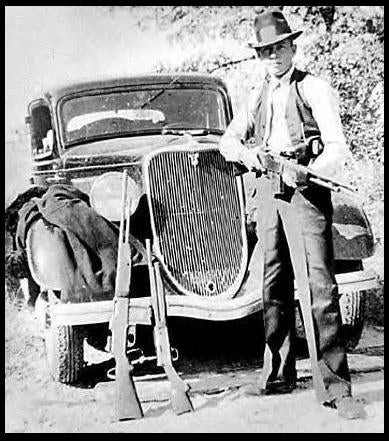 Here's a photo of Clyde holding a BAR with another leaning against the bumper of a car next to a shotgun. Photo from PBS.com.
