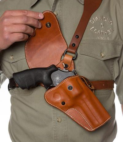 Shoulder or chest holsters for hunters keep large-frame revolvers at the ready while not interfering with other gear.
