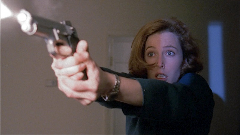 Scully firing her S&W 5906. The 10mm S&W 1076 was too much for the actors, just like it as too much for the real FBI.