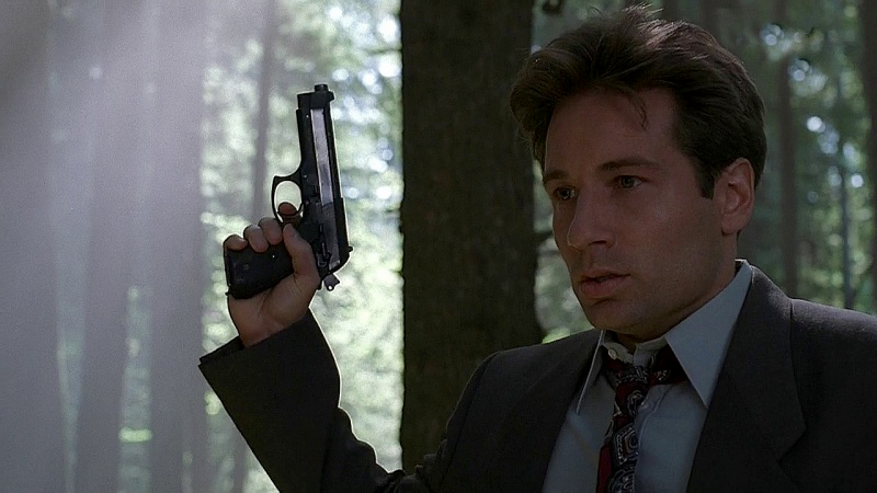 The show began with Mulder carrying a Taurus PT92, a clone of the Beretta 92FS or the M9 pistol.