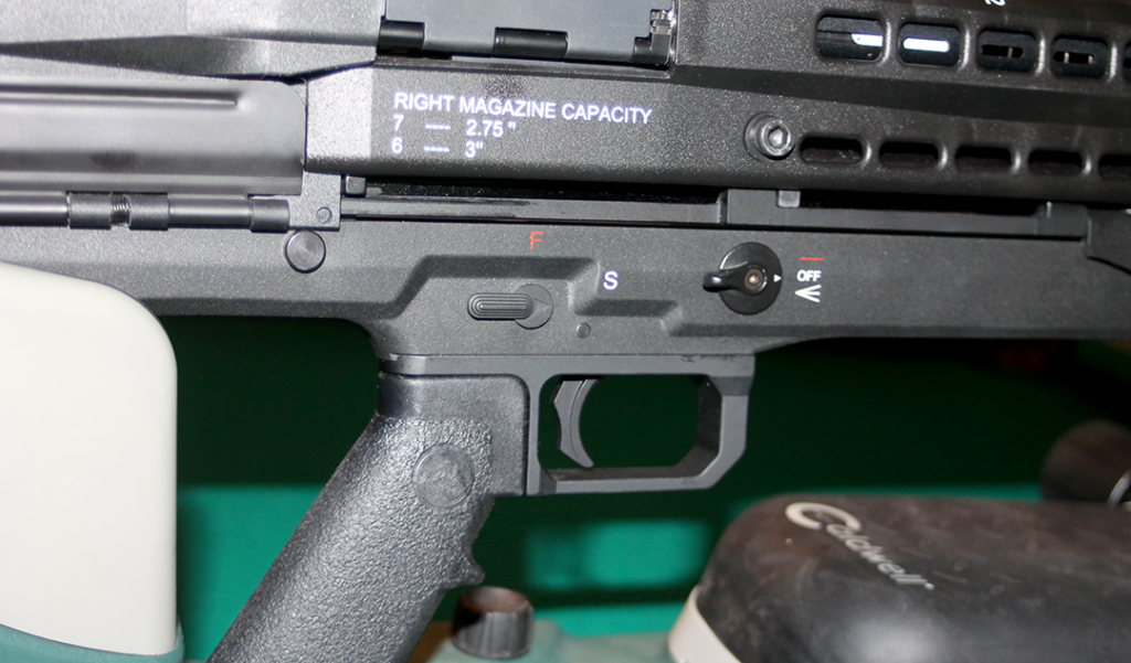 Here you can see the UTS-15's AR-style, ambidextrous safety lever and the ambi control for the integrated light and laser sight, along with the A2 style grip.