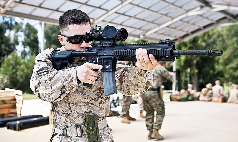 A U.S. Marine armed with an M27 IAR fitted with an ACOG Squad Day Optic.