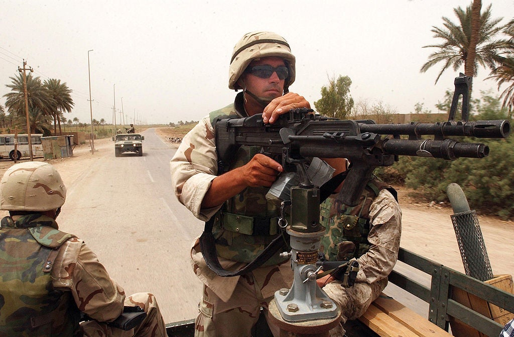 A mounted M60E4 crewed by a Seabee on a convoy in Iraq, May 2003.