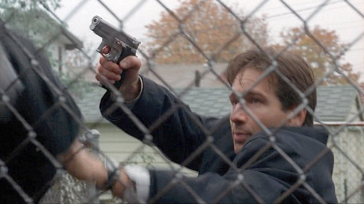 Mulder with his  S&W 5906, meant to stand in for the S&W 1076, which were briefly issued by the FBI at the time.