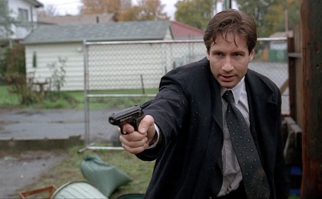 It's revealed that Mulder sometimes carries a Walther PPK in an ankle holster as a backup pistol.