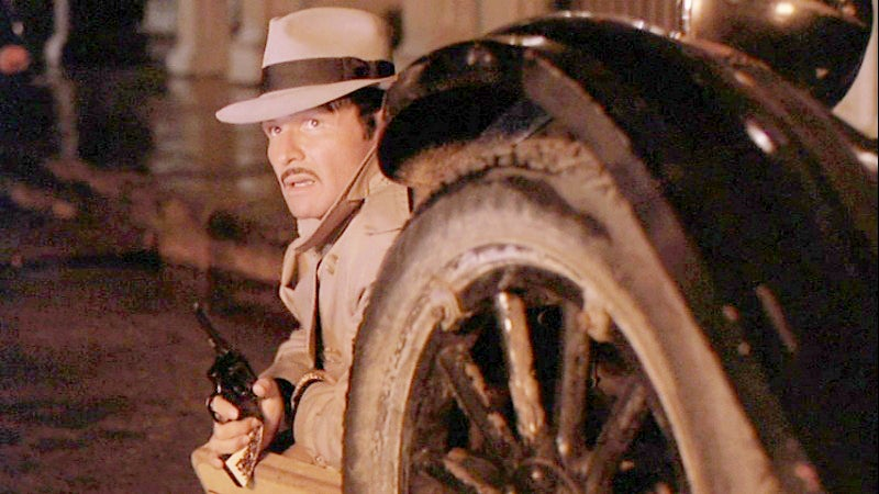 Murphy takes cover with his Colt Official Police revolver.