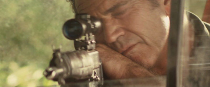 As the titular character in *Get The Gringo*, Gibson aims an AR-18 rifle.