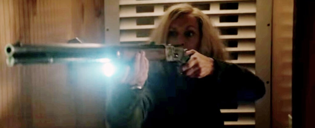 You can see one of the room door gates closed behind Laurie, as she clears the halls, holding a flashlight against her rifle with he support hand.