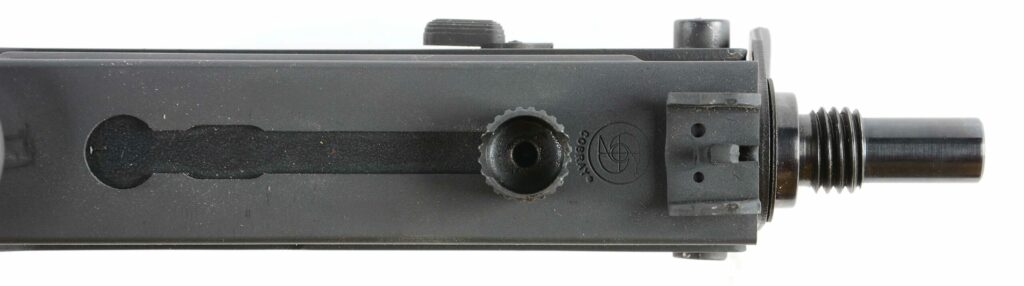 The M10's bolt is located on top of the receiver.