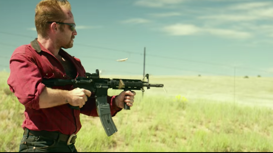 Tanner with his fully automatic Colt M933 compact carbine and magazines taped together jungle-style.