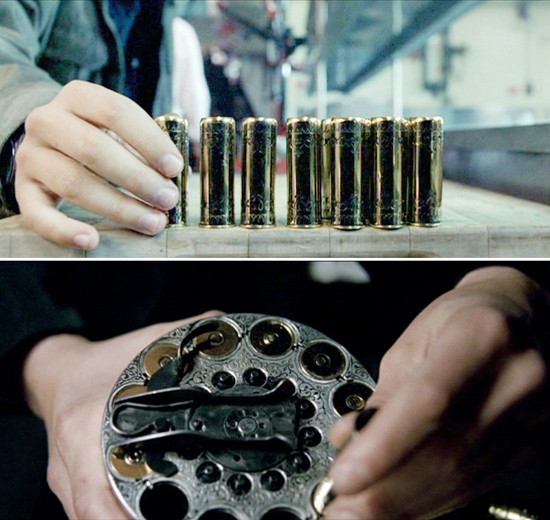 The gold shells are heavily engraves and loaded in a removable cylinder-type magazine.