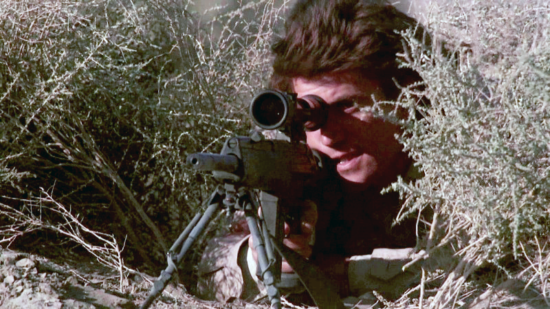 Riggs aims the Heckler & Koch PSG-1 sniper rifle in *Lethal Weapon*.