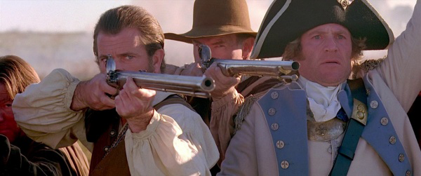 Gibson with a flintlock rifle as Benjamin Martin in *The Patriot*.