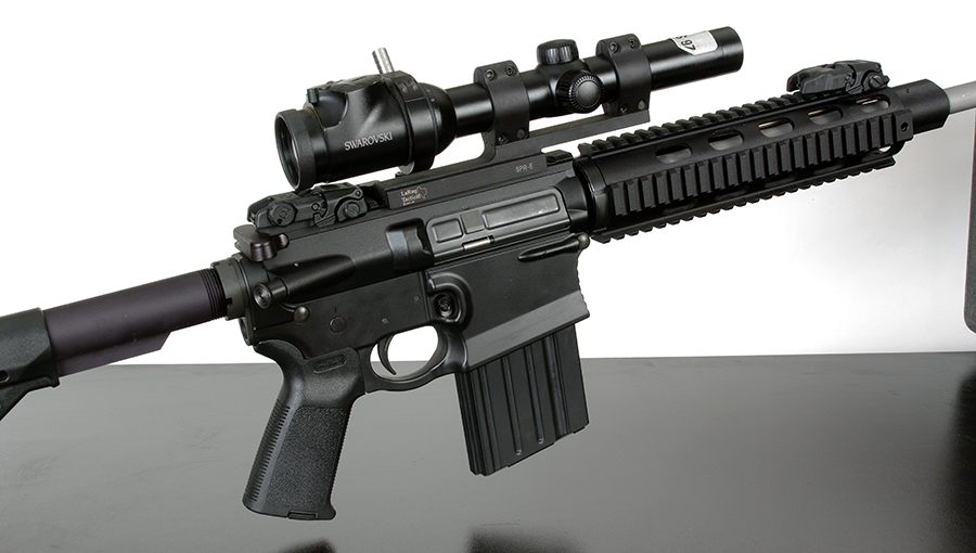 A 1-6x scope, as is used in 3-gun matches, will serve well for defense.