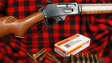 lever action rifle on plaid background