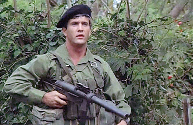 Gibson with a suppressed Grease Gun in the Australian-made *Attack Force Z*.