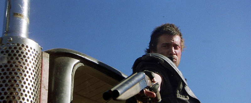 Gibson with the sawed-off in the Mad Max sequel, *Road Warrior*.