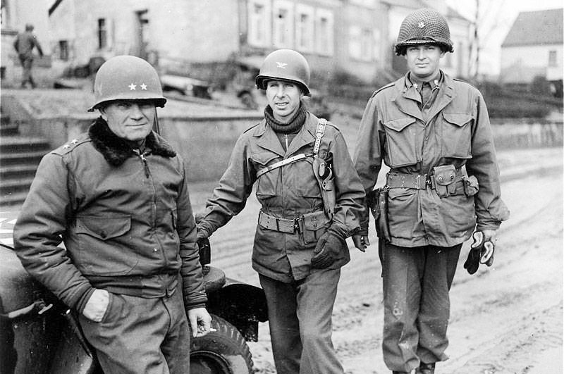 U.S. soldiers in WWII wearing the infamous M7 shoulder holster for the M1911A1.