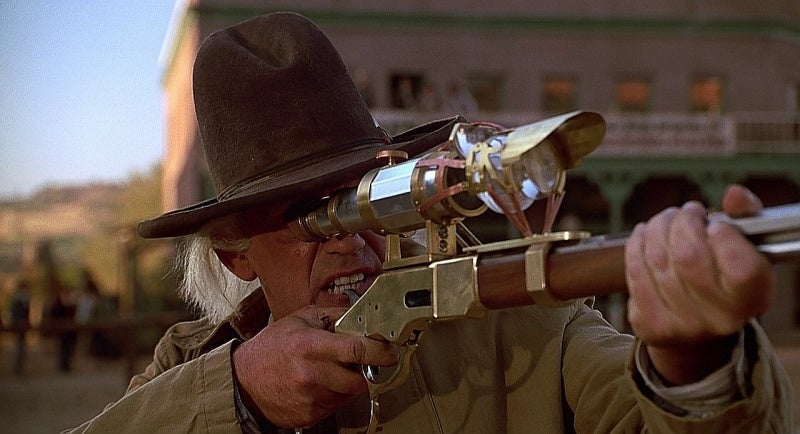Doc Brown in 1885 with his customized Winchester Yellow Boy rifle.