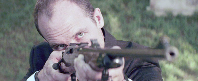 Ambrose's son, Will (Ethan Embry) fires his dad's Model 700 rifle.