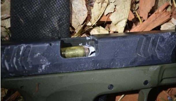 Cop's .45 Bullet Goes Down Barrel of Suspect's .40 Cal