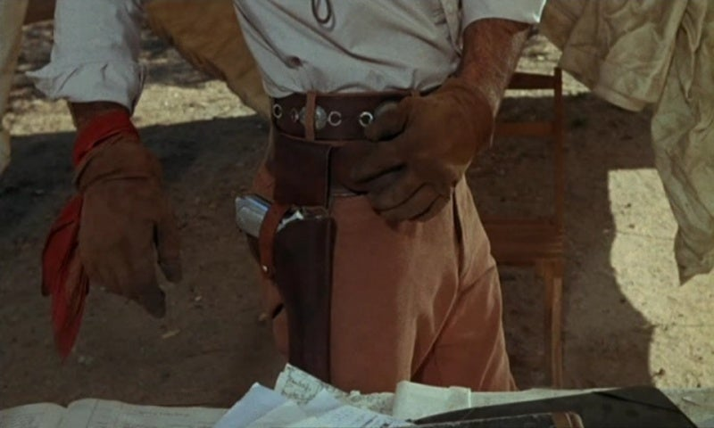 Yaqui Joe carries one of Varduga's Colt 1902 pistols after taking his place.