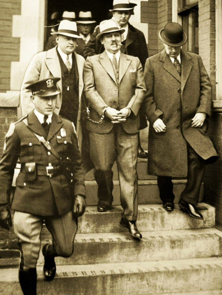 black and white image of burke and officers