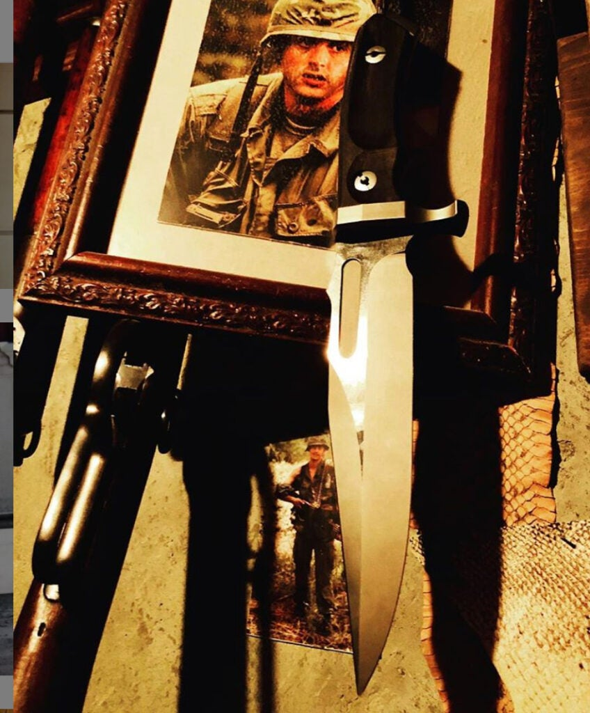 Rambo's smaller knife shown with a photoshopped image of a young John Rambo in Vietnam.
