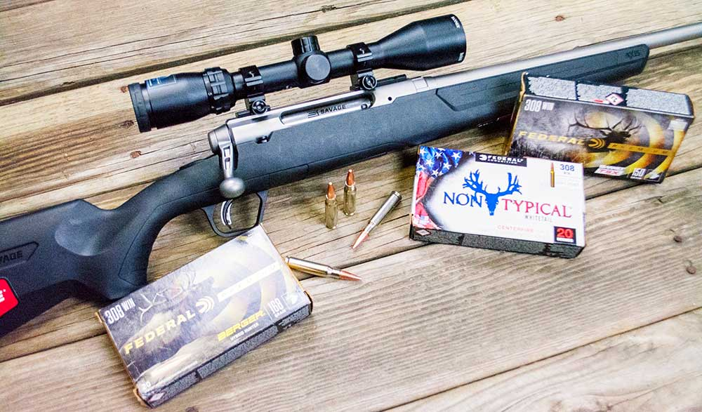 savage axis ii rifle and three boxes of gun ammunition