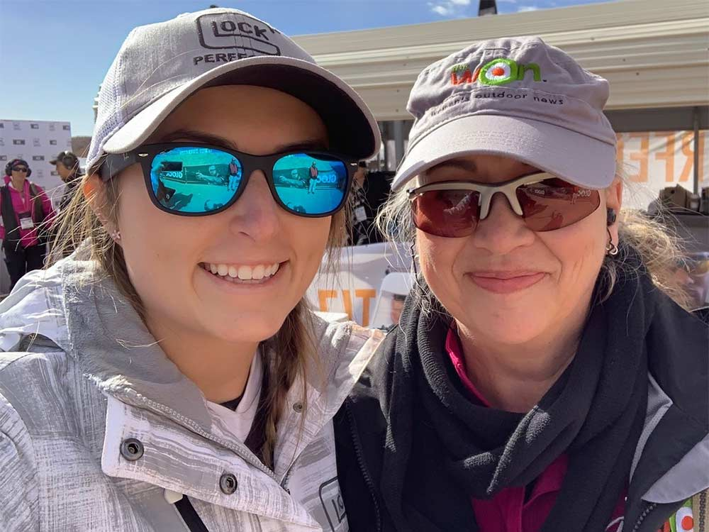 two women at industry day at the range