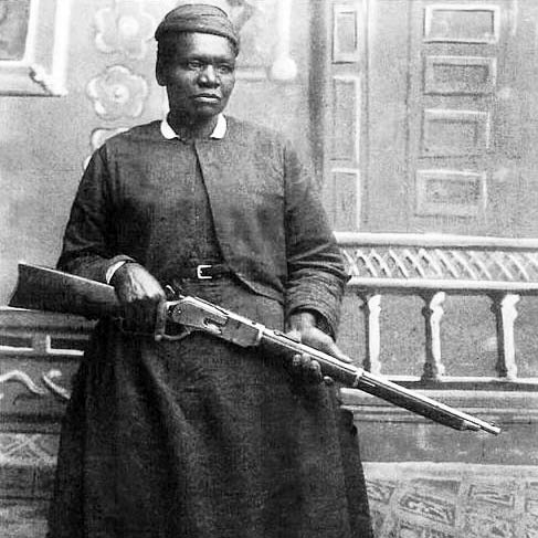 black and white image of mary fields holding a gun