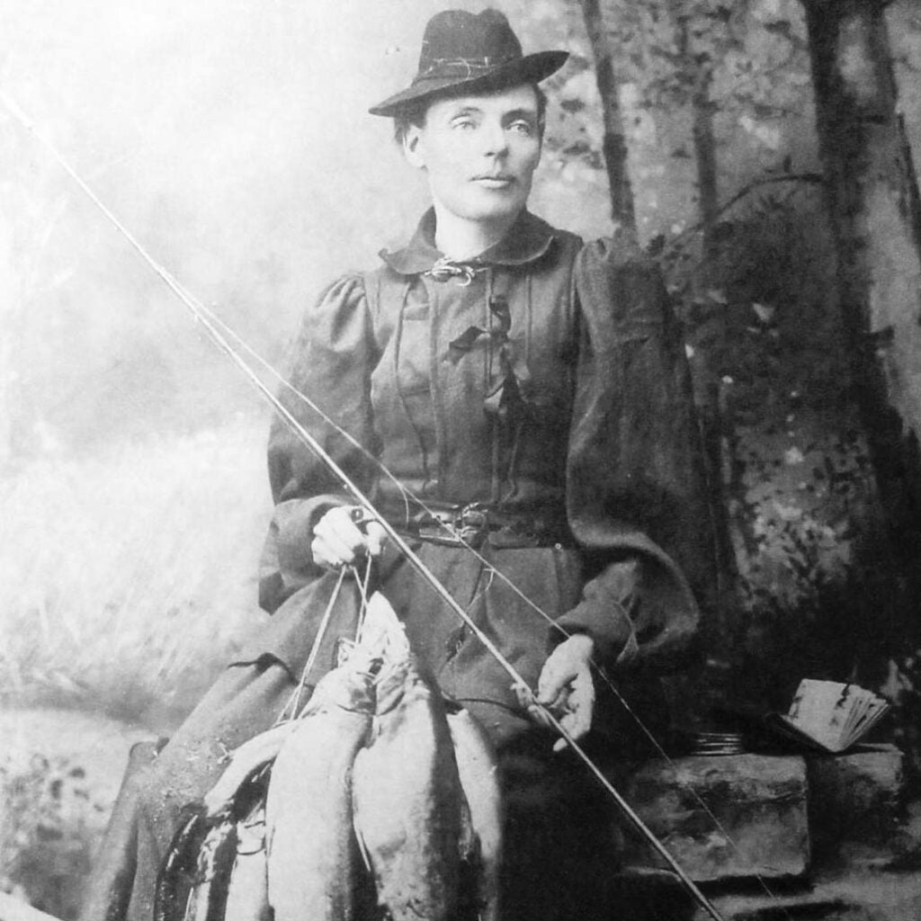 fly rod crosby holding a string of fish