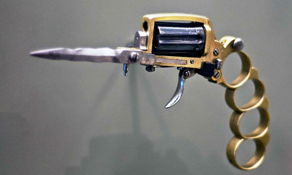 brass knuckles and dagger revolver