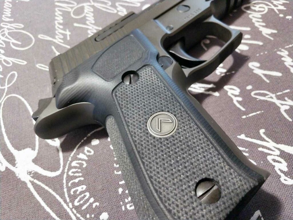 The checkered grip of the sig p226 legion
