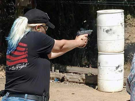 kat ainsworth firing a handgun