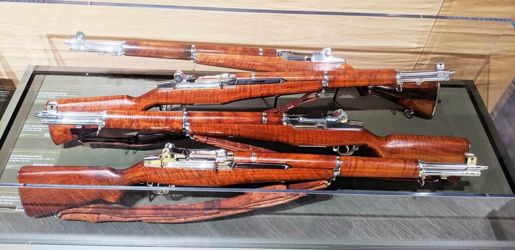 a collection of winchester rifles