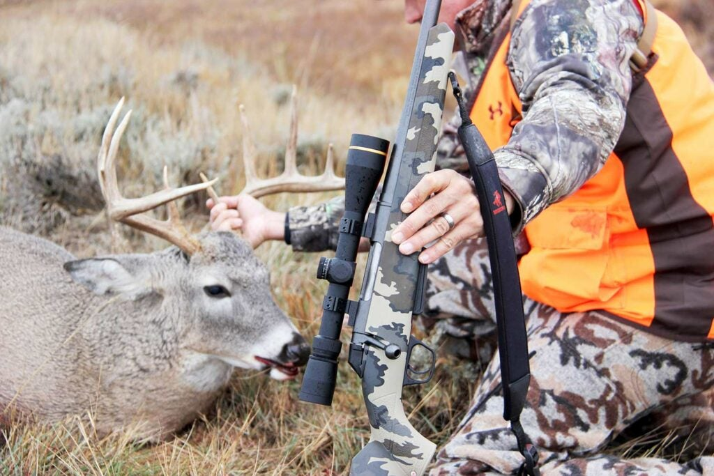 scoped Winchester XPR rifle and a whitetail deer