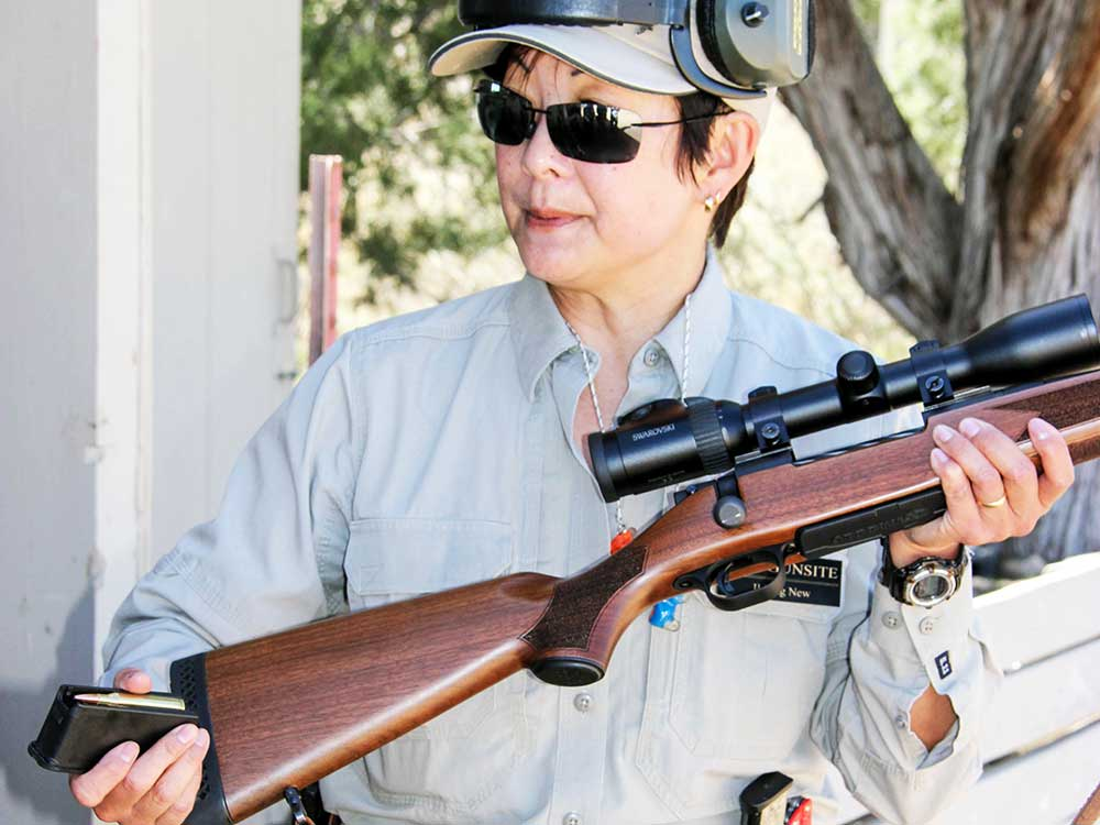 Il Ling New holding a rifle