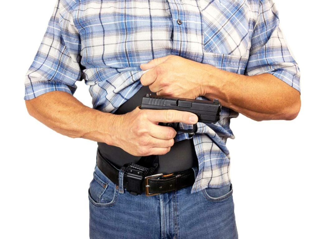 man with concealed carry appendix holster