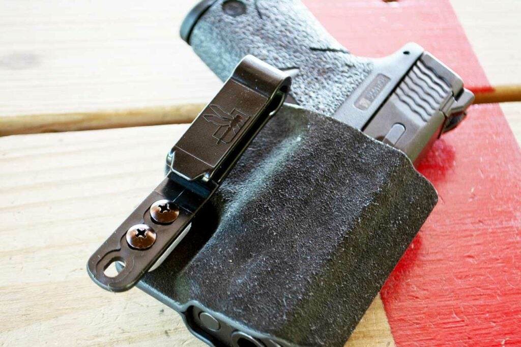 a concealed carry holster with a gun