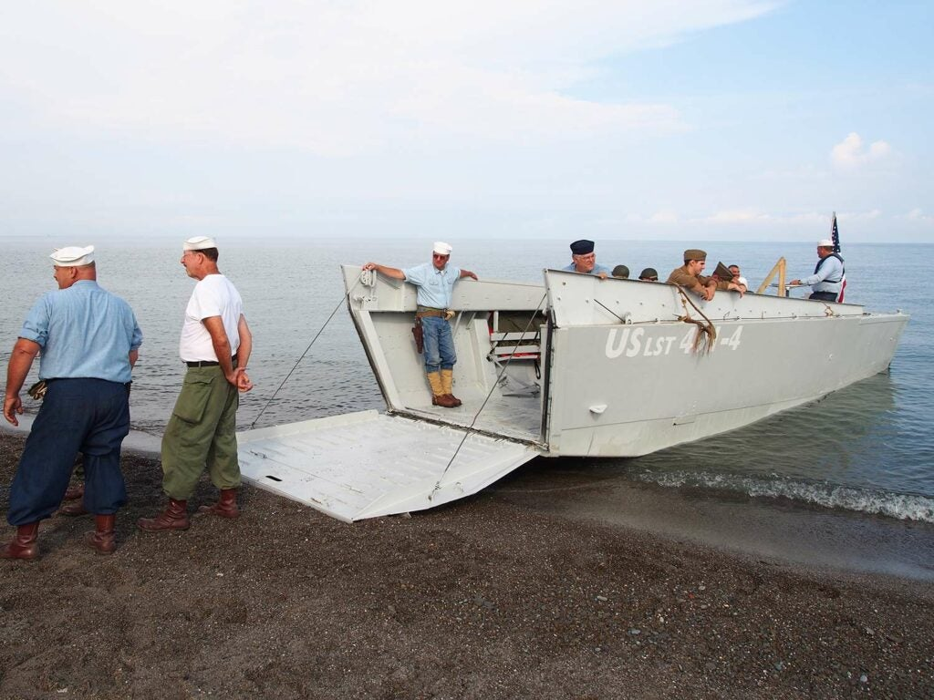 a lst landing craft with usn soldiers