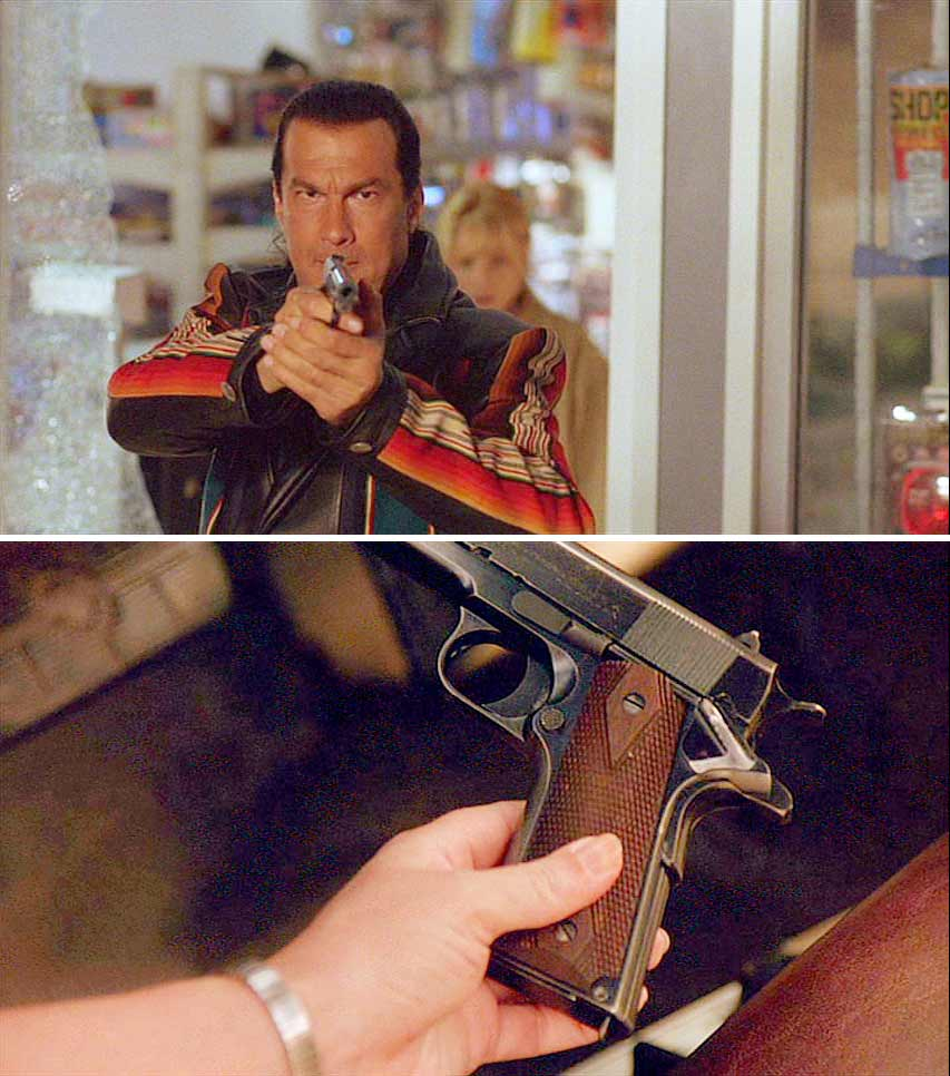 seagal holding a m1911a1 pistol