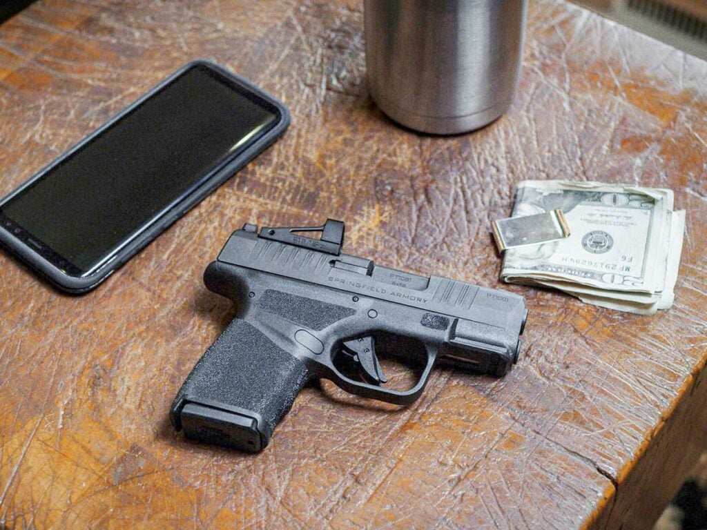 springfield hellcat pistol on a side table.